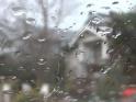 RAIN – 37 – HOUSE IN WET WINDOW GLASS – $10
